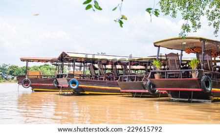 TIEN GIANG, VIETNAM - OCT 5, 2014: Touristic boat on the Mekong river in Southern Vietnam. Mekong is the 12th-longest river and flows trough China, Burma, Laos, Thailand, Cambodia, Vietnam