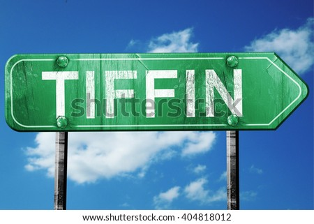 tiffin road sign , worn and damaged look