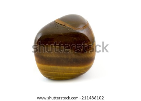 Tiger's eye adorable gemstone close up white background. Gives confidence and protection.