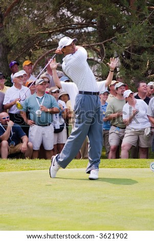 Tiger Woods drives the ball at the 2007 Memorial Golf Tournament in Dublin Ohio.  This is the fourth shot in a six shot series. - stock photo