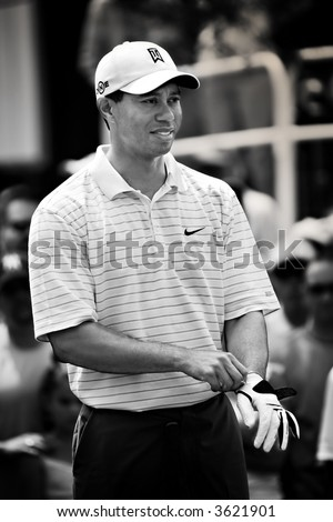 Tiger Woods preparing to tee off.  2007 Jack Nicklaus Memorial Golf Tournament in Dublin, Ohio. - stock photo