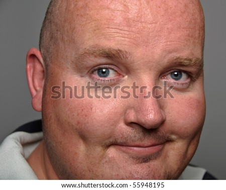 tight close up of overweight male head - stock photo