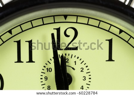 Tight shot of clock centered on twelve o'clock - stock photo