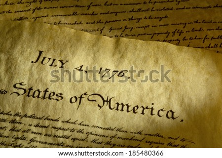 Tight shot of date on the Declaration of Independence that was signed on July 4th, 1776. Adoption of this historical document lead to the War for Independence between the colonists and England. - stock photo