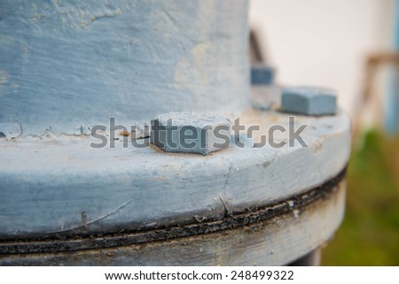 Tighten the bolts that connect the steel pipe. - stock photo