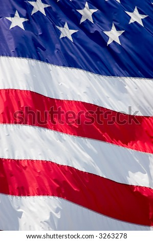 Tightly cropped background photo of the American flag. - stock photo