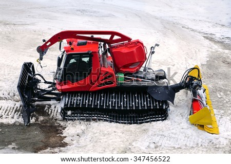 TIGNES, FRANCE - APRIL 28: Snowcat on snow for preparing and clearing the track on the winter resort on  April 28, 2012 in Tignes, France