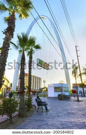 TIJUANA, MEXICO - FEBRUARY 26 2014: The Millennial Arch (Arco y Reloj Monumental) at the entrance of Avenida de revolucion, at zona centro and a landmark that welcomes tourists, Bienvenidos a Tijuana. - stock photo