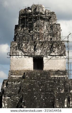 tikal, guatemala, rainforest, travel, city, belize, nature, mayan, culture, ruins, architecture, tourism, ancient, history, religion, tourist, monument, temple, central, pyramid, sky, old, park, stone - stock photo