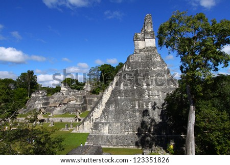 Tikal - Pyramid at the Mayan archaeological site in the rain forest of Guatemala - stock photo