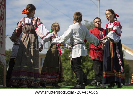 TIKHVIN, RUSSIA - JULY 5, 2014: Unidentified participants the celebration of the day of the city of Tikhvin - first mentioned 1383, town status since 1773 year (200 kilometers east of St. Petersburg)