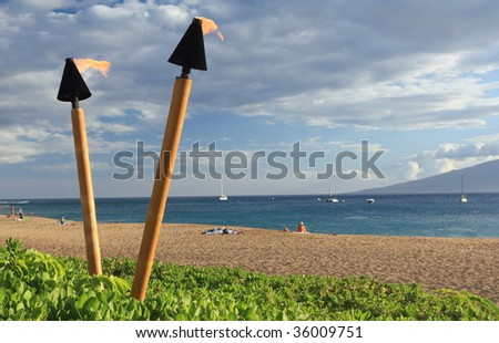 tiki torches on the beach