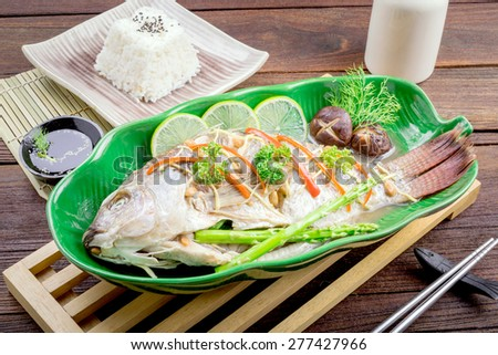 tilapia fish steamed with soy sauce, Thai food. - stock photo