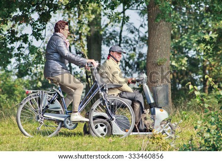 TILBURG-HOLLAND-OCT. 4, 2015. Elderly woman on Koga Miyata bike. Koga Miyata was a Dutch manufacturer of high-range bicycles. The brand stopped in 2010 and continued under the international brand Koga