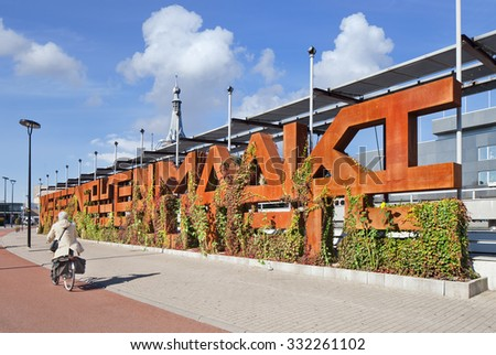 TILBURG-HOLLAND-OCT. 1, 2015. Tilburg Whine Wall, art object in city-center. Big rusty letters must be covered with green plants. Together the letters form a sentence that demonstrates self-criticism - stock photo