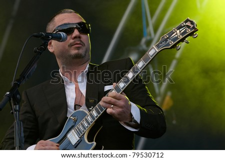 TILBURG, THE NETHERLANDS - JUNE 19: Fun Lovin' Criminals Hugh Morgan sings on the second day of the two-day Festival Mundial on June 19, 2011 in Tilburg