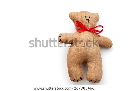tilde toy - bear. isolated on white background. space for inscriptions.