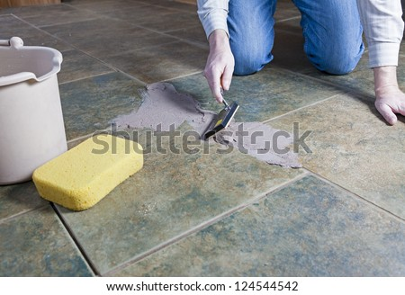Tile grout repair - stock photo