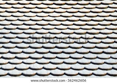 Tile roof in the snow. Winter background