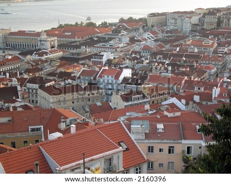 Tile roofs in the old Lisbon centre Alfama, River tejo in the background. - stock photo