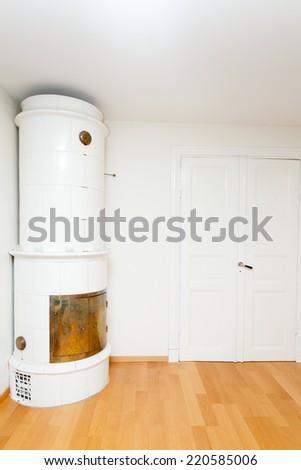 tile stove in livingroom - stock photo
