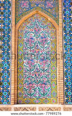 Tiled background, oriental ornaments from Vakili Mosque, Shiraz, Iran - stock photo