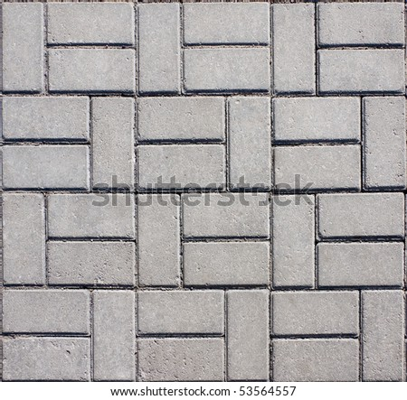 Tiled mosaic concrete pavement of the road - stock photo