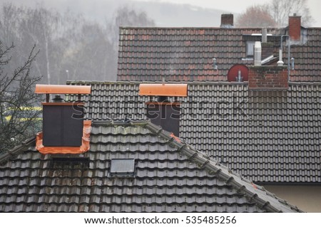 Tiled Roof with copper covered Chimney