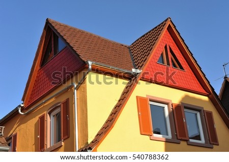 Tiled Roof with Part of House Gable with Window and Eaves Gutter