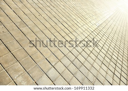 Tiled sidewalk and light