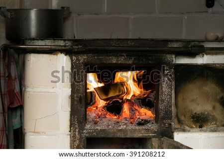 Tiled stove and a blazing fire