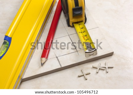 tiler, tiles and planning work on construction - stock photo