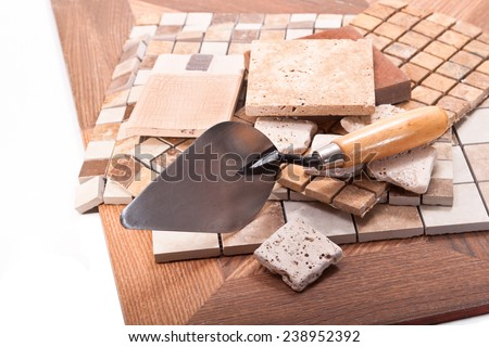 Tiles for walls, floors, kitchen and trowel - stock photo