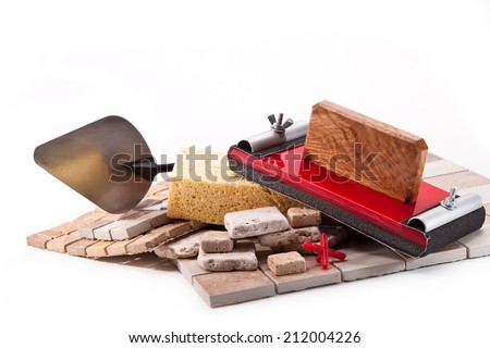 Tiles made of stone and marble, a device for grinding walls, sponge, trowel - stock photo