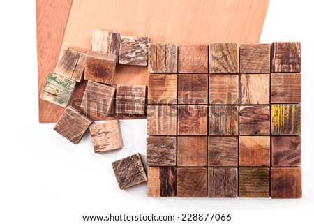 Tiles made of wooden squares on a white background - stock photo