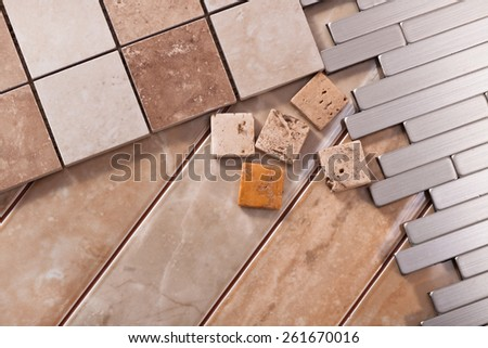 Tiles of different forms of ceramic, natural stone and aluminum