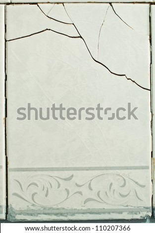 Tiles with a crack - structural damage - stock photo