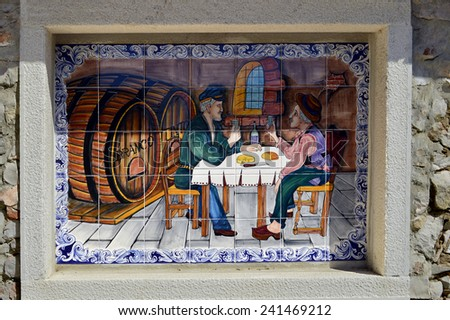Tiles with two men drinking in Alte, Portugal