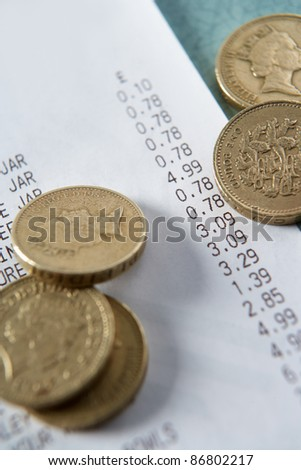 Till receipt and coins - stock photo