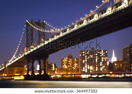 Tilt shift Manhattan bridge night horizontal view in New York City