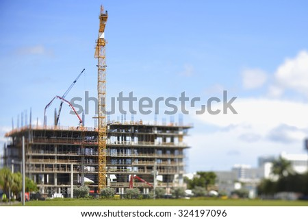 Tilt shift miniature construction site - stock photo