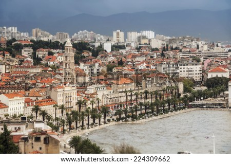 Tilt-shift Miniature of Split, aerial view - Dalmatia city in Croatia and one of the oldest in the area. It has the examples of Romanesque, Gothic, Renaissance and Baroque architecture - stock photo