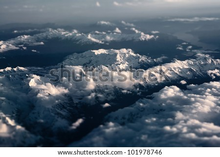 Tilt-shifted shoot of Alps from an aerial view - stock photo