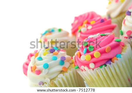tilted plate of cupcakes on a white background with space for text. - stock photo