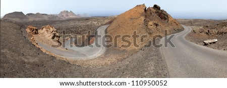Timanfaya National Park, Road in volcanic stone desert on Lanzarote, Canary islands, Spain - stock photo