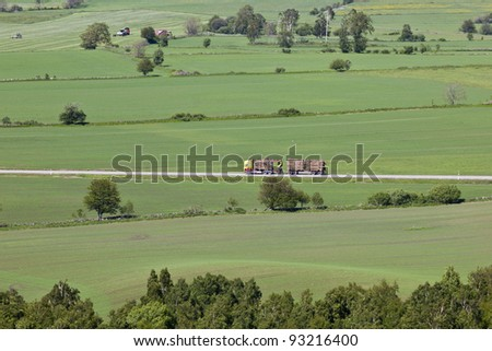 Timber truck on the road - stock photo
