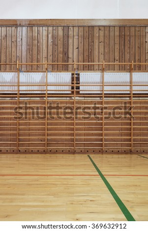 Timber wall bars in old gymhall - stock photo