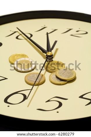 Time and money concept - clock and euro coins - stock photo