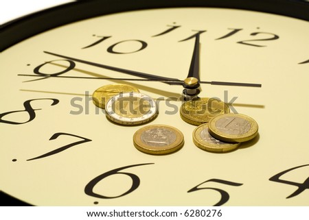 Time and money concept - with euro coins - stock photo