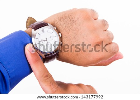 Time concept, businessman looking her watch, isolated on white background. - stock photo